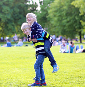 Two kids playing in a park.