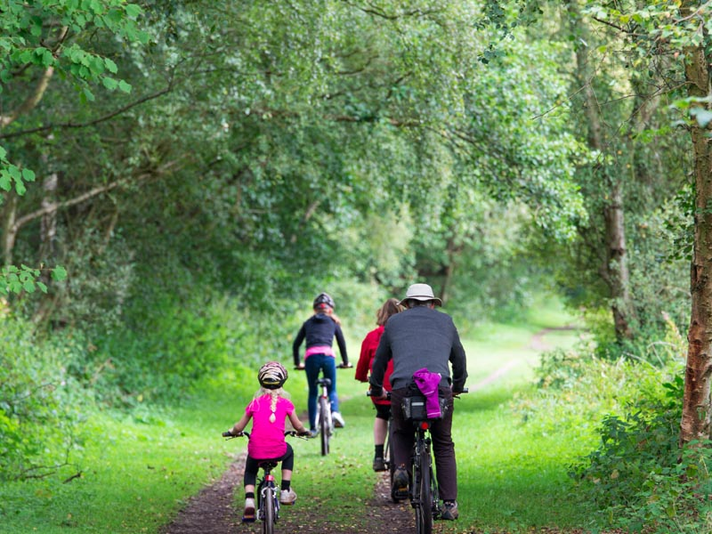 Family cycling off-road.