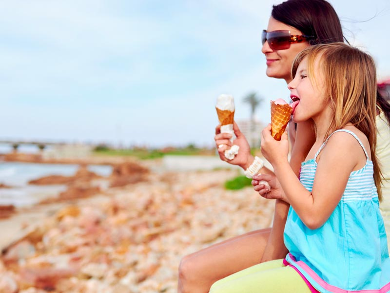 Mum and daughter enjoying an ice cream together.