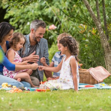 Family picnic on a sunny day.