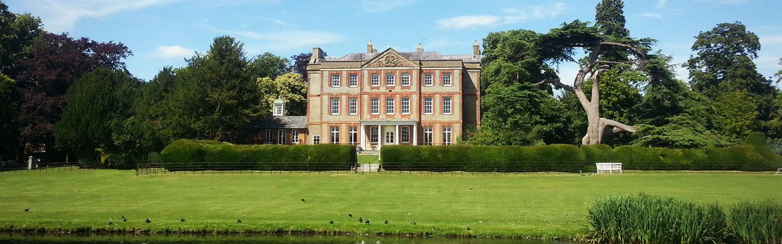 luxury manor house with lake.