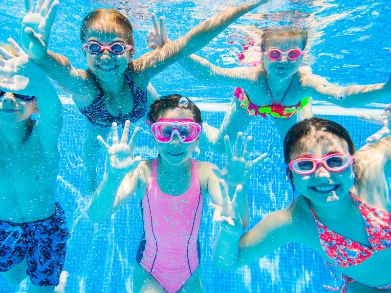 Kids enjoying the swimming pool.
