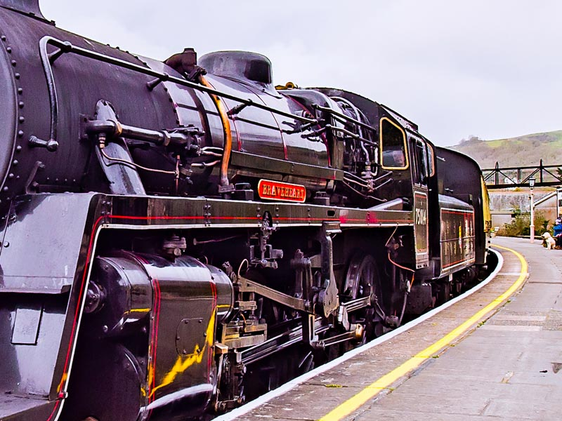 Steam train at a station.