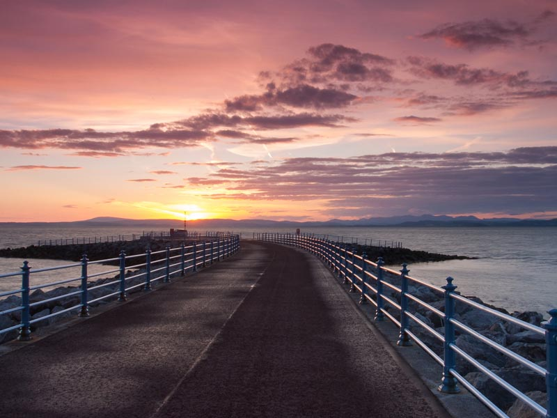 Sunset on the pier in Morecambe.