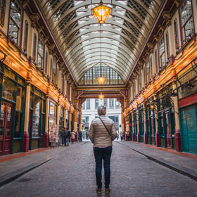 Man walking through Leadenhall Market, London.