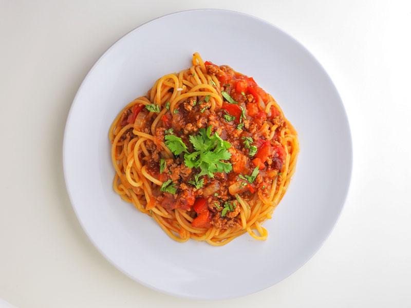 Spaghetti bolognese being served in an italian restaurants.