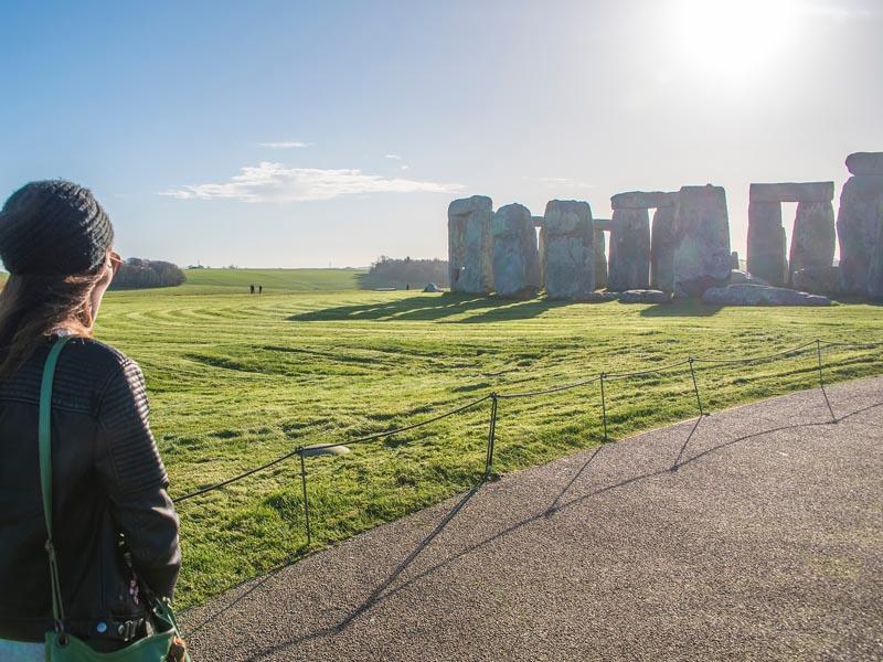 A tourist sightseeing at Stonehenge.