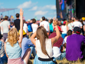 People enjoying music festival.
