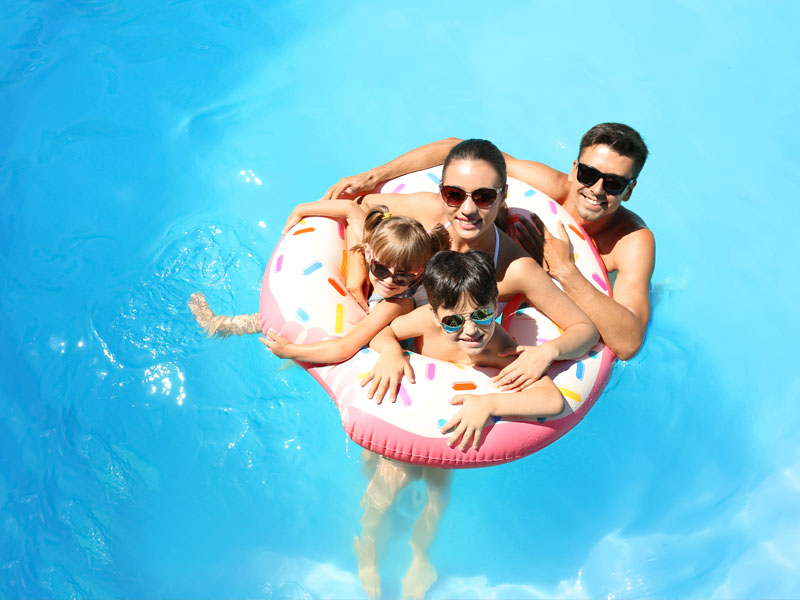 Family in a swimming pool.
