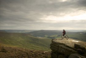 Mountain biker looking over the Peak District.