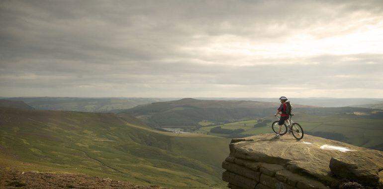 Mountain biker looking over the Peak District.