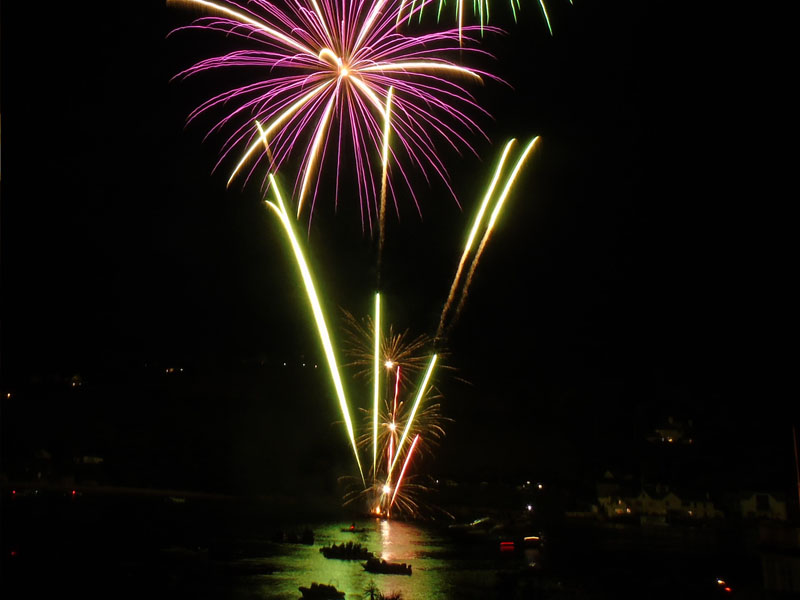 Fireworks reflecting in the waters of Salcombe harbour.